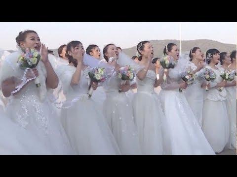 شاهد حفلة زفاف جماعية لجنود من القوات البحرية الصينية