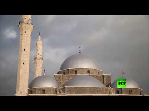 شاهد مراسم إعادة افتتاح مسجد خالد بن الوليد في حمص