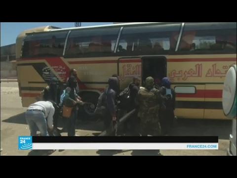 اليمن اليوم- بالفيديو مسلحو حي الوعر في حمص يغادرونه إلى إدلب وجرابلس