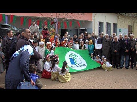 شاهد مراسم تسليم اللواء الأخضر لمؤسسات تعليمية بعين تاوجدات