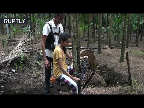 شاهد مزارع هندي يبتكر دراجة لتسلق الأشجار